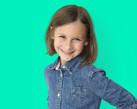 Short haired brunette young girl smiling studio portrait