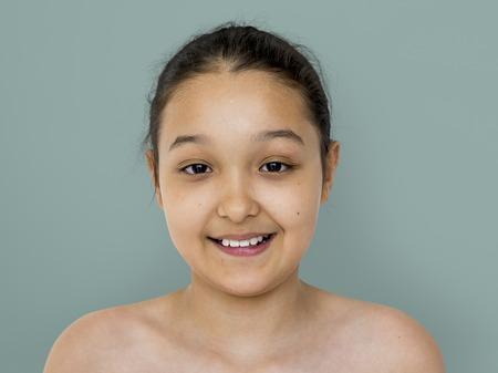 Little girl smiling bare chest studio portrait