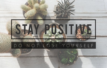 Staying positive concept with background