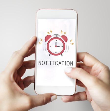 Notificación de alarma de teléfono móvil para una cita importante Foto de archivo - 78476492