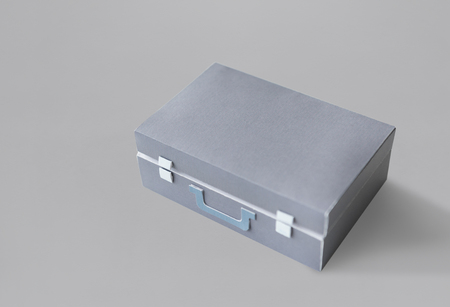 aluminum: Closed Suitcase in Grey with Green Handle Isolated Stock Photo