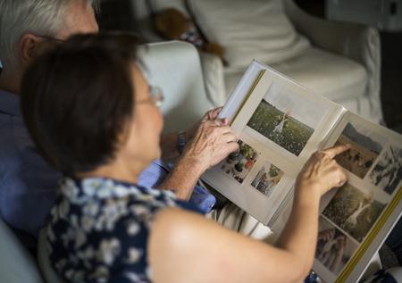 Senior Couple Look Photo Album Stock Photo