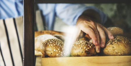 Man Hand Picking Baked Bread
