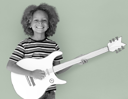 Child with an electric guitar concept