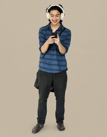 Young man full boady listening music on smart phone Stock Photo