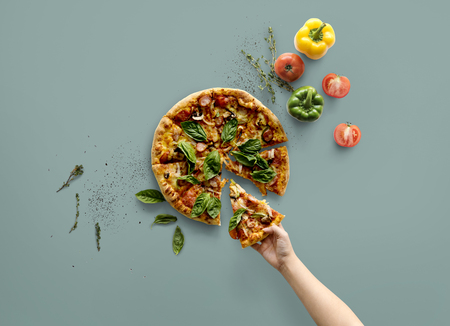 hand bell: Hand taking a slice of italian cuisine pizza