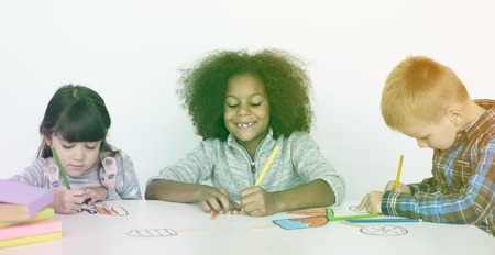 Young children participating in drawing class Stock Photo