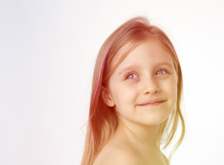 Young girl standing shirtless posing for picture Stock Photo