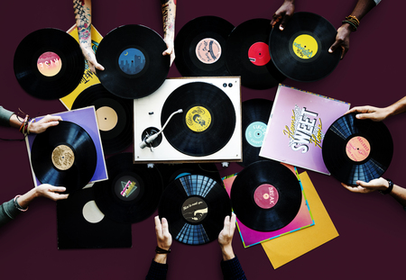 Hands holding vinyl records