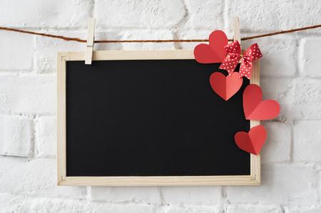 Diseño de la decoración del corazón de la tarjeta negra Foto de archivo - 79107508