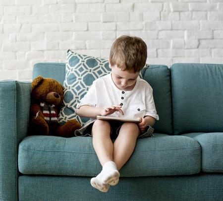 techie: Son Boy Kid Playing Techie Digital Device Stock Photo