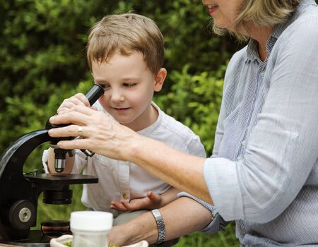 micro organism: Grandmother Grandson Family Science Microscope