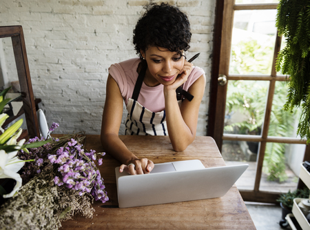 Woman Using Laptop Online Flower Shop