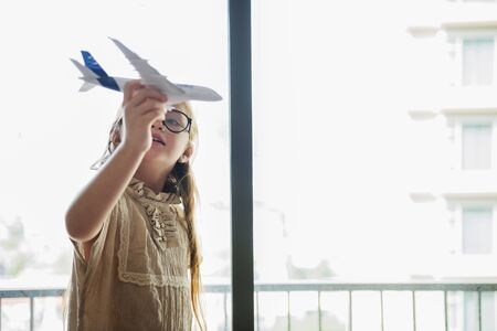 Girl Playing Plane Toy Concept Stock Photo