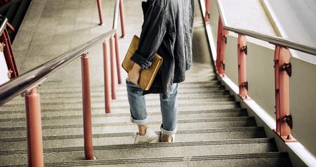 Asian Guy Walking Down Stairs