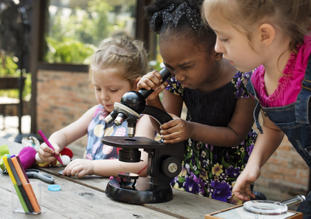 Little Girls Using Microscope Learning Science Class Stock Photo