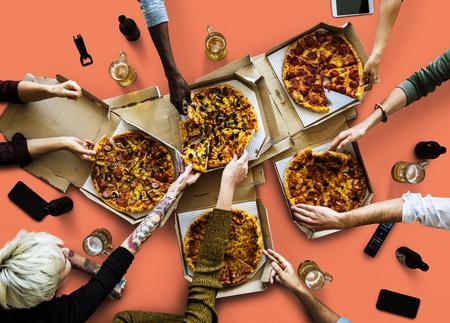 Group of poeple enjoy the italian cuisine pizza Stock Photo
