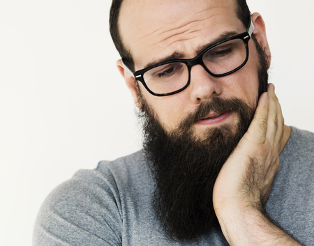 Depressed sad man felling bored studio portrait