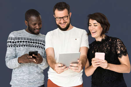 woman on phone: Happiness group of people smiling and conneted by digital devices Stock Photo