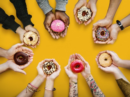 People holding donuts 스톡 콘텐츠
