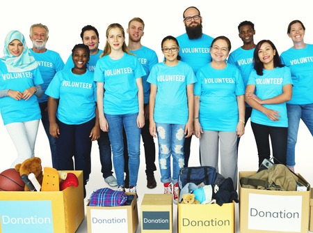 Group of volunteer people donate stuff for charity Stock Photo