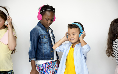 Happiness group of cute and adorable children listening music Stock Photo