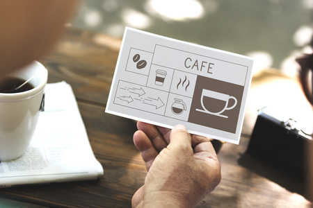 Man drinking coffee with Illustration of coffee shop advertisement on flyer Stok Fotoğraf