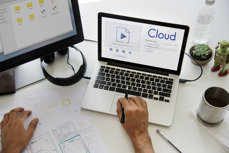 keyboard: Hands sharing uploading a file to cloud storage