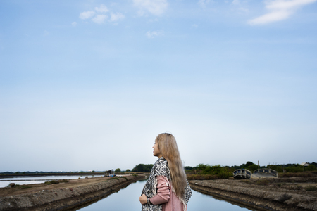 Traveler Woman on a journey near by pond