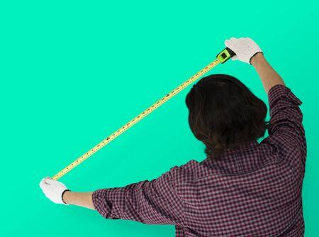 Man Using Tape Rule Measure Studio Stock Photo
