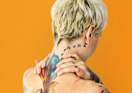Woman with tattoos on her back Banque d'images
