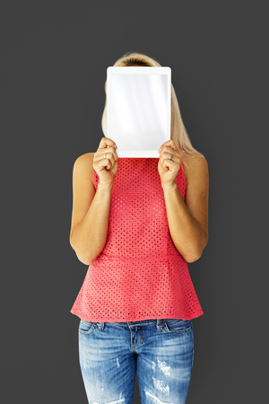 Woman holding tablet cover her face Stock Photo
