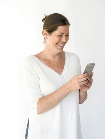 woman on phone: Adult Caucasian Woman Using Mobile Stock Photo