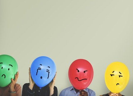 Group of Diverse People Faces Covered with Emotion Expression Balloons Reklamní fotografie