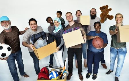 Group of volunteer people donate stuff for charity Zdjęcie Seryjne