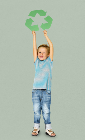 Caucasian Ethnicity Boy holding Recycle Sign Stock Photo