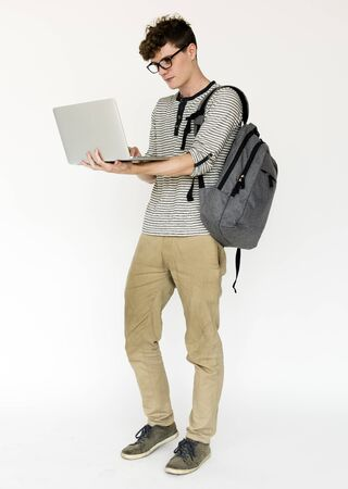 Young adult man using laptop