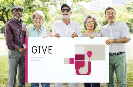 Group of senior adult holding banner of blood donation campaign Stok Fotoğraf