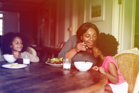 母と娘が一緒に食事 写真素材