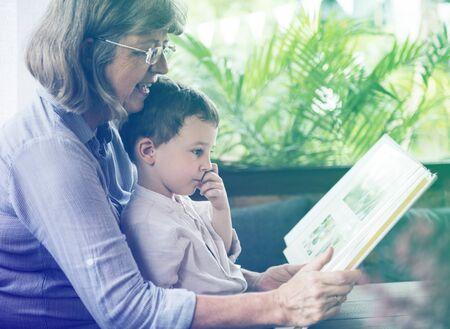 Grandmother raise up little cute grandson