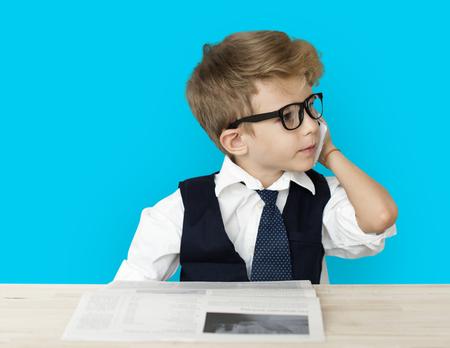 niños vistiendose: Little Boy Businessman Working Busy Foto de archivo