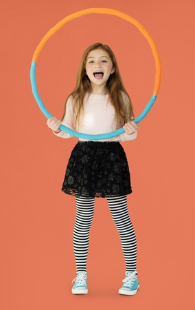Young girl holding a hula hoop
