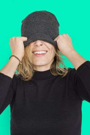Caucasian Lady Beanie Covering Eyes Smiling