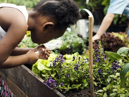 Kid is in a garden Stock Photo