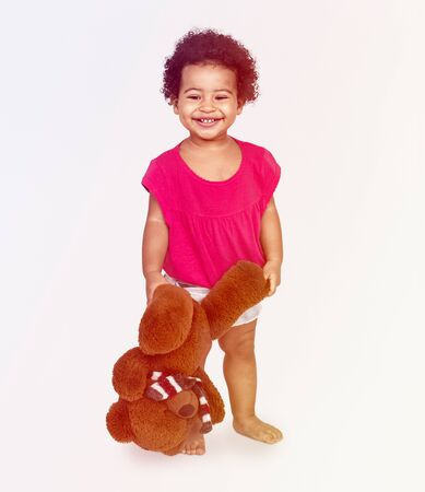 Little Girl Brown Teddy Concept Stock Photo - 79318419