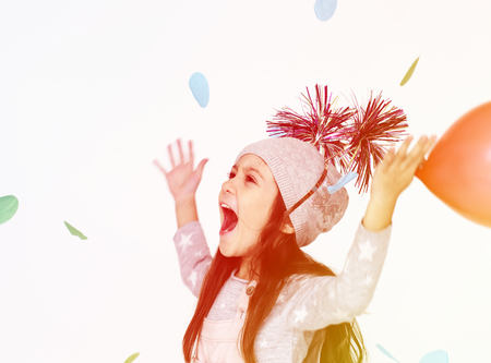 Young girl cheering in happiness Stock Photo