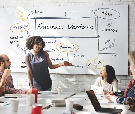 Woman presenting about business ventures Stock Photo