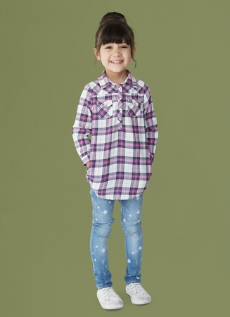 hands pocket: Young girl with a bun smiling full body portrait