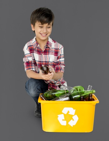 Young Boy Separating Recyclable Glass Bottles