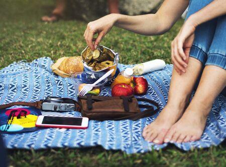 Woman eating snack picnic at park